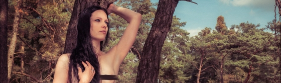 Summer Nude - Natural Nude Art in the Nature with beautiful long haired girl posing topless on a tree showing her naked body - © by Magistus