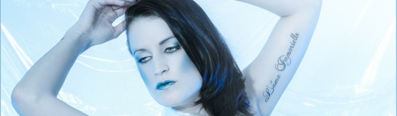 Ice Princess - Nude Art Photoshoot with beautiful girl posing naked in transparent canvas with blue light - © by Magistus