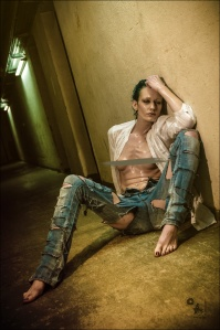 Raw Jeans - Erotic Jeans Nude Photoshoot with fantastic model sitting topless in a dark floor wearing cut blue jeans. - © by Magistus