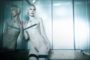 Naked Elevator - Nude Art Photoshoot onLocation with a cool skinny naked model posing in an elevator in front of a mirror shwoing her perfect and hot body - © by Magistus