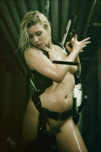 Naked Shooter - Erotic Fightergirl Photoshoot with fully naked blonde model posing with a gun showing her naked tits. - © by Magistus