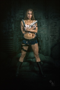 Dirty Fighter - Sexy Dirtylook Fightergirl Photoshoot with hot girl in short jeans hotpants posing with a dagger and gun covered in dirt and blood all over her tight body. - © by Magistus
