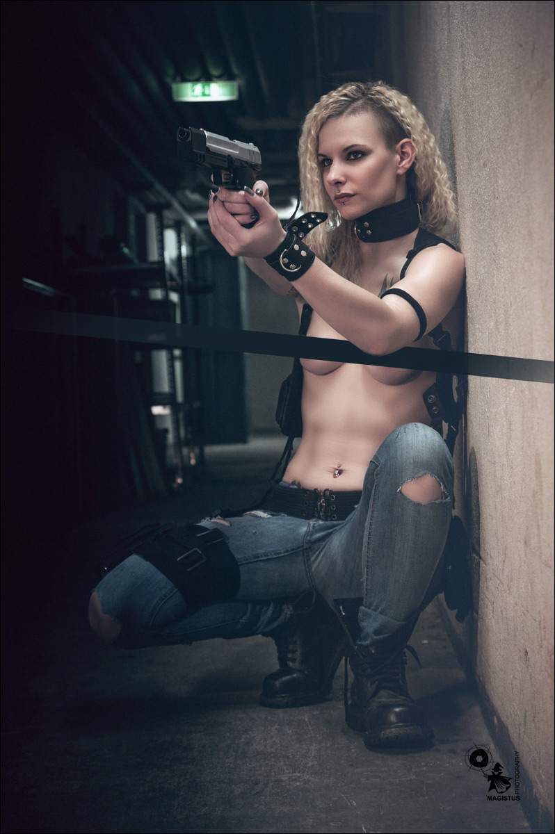 Erotic Fighter - Super hot and sexy fightergirl photohsoot with fantastic model posing topless in jeans and a gun in her hands - © by MagistusFoto