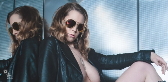 Hot Elevator Shooter - Erotic Fightergirl Photoshoot with super hot and busty model posing half naked and cool in the elevator with a gun in her hand - © by Magistus