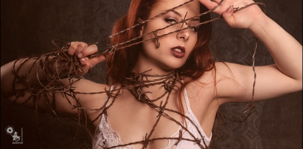 Barbwire Beauty - Super sexy and busty model posing with barbwire - © by MagistusFoto