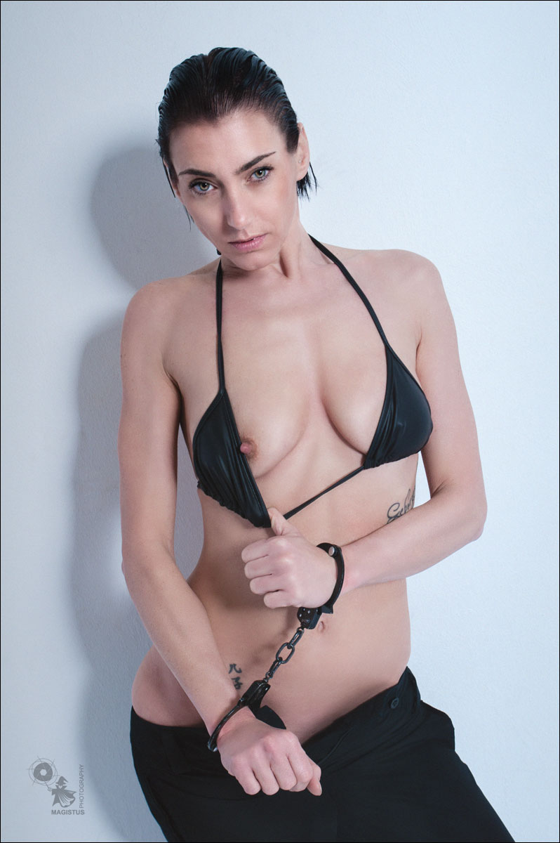 Black Handcuffs - Topless and Sexy Bikni Girl catched with handcuffs - © by MagistusFoto