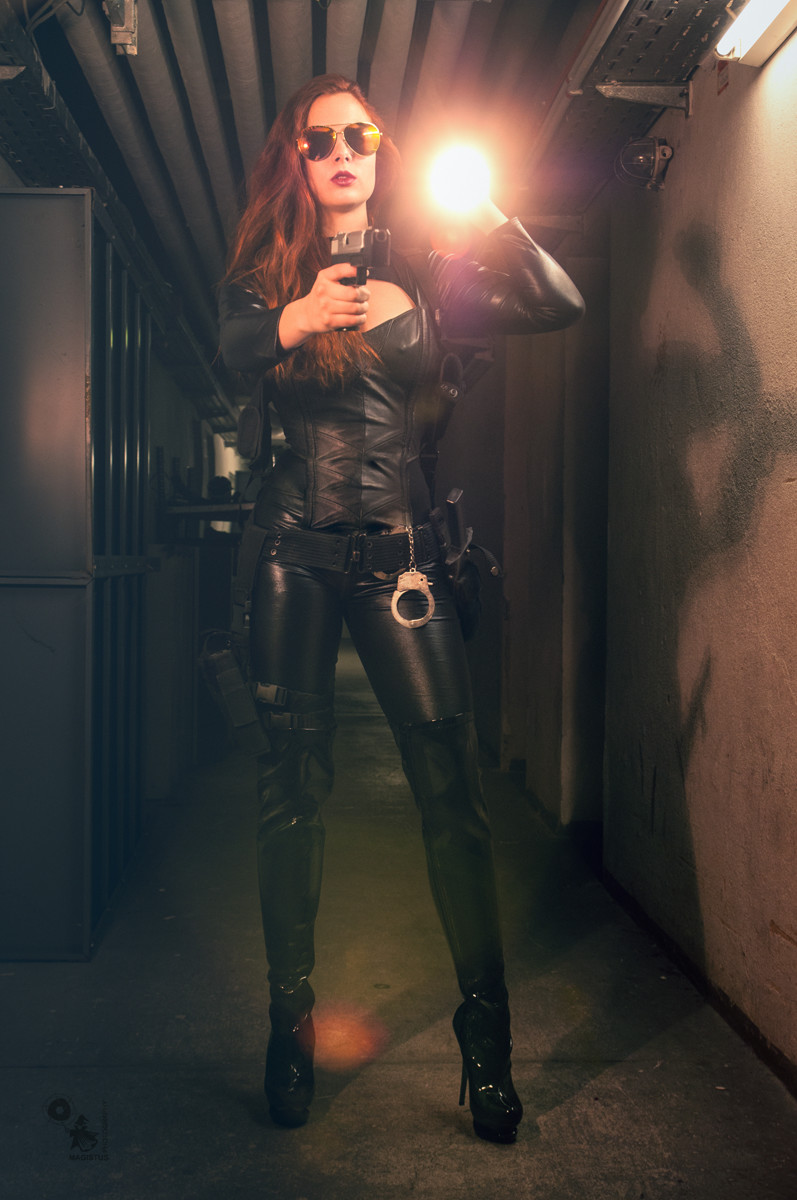 RECON - Hot Fightergirl in a tight black leather dress is reconning a dark place with a gun in her hand - © by Magistus