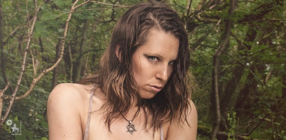 Bound in Nature - Erotic Bondage Photo with busty Girl bound naked in the woods showing her big boobs - © by Magistus
