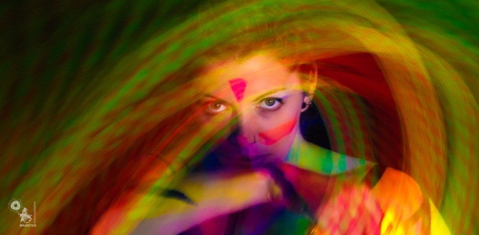 Color Swirl - Bodypainting Art with Long Time Exposure and UV-Light - © by Magistus & Farbtraeume.com