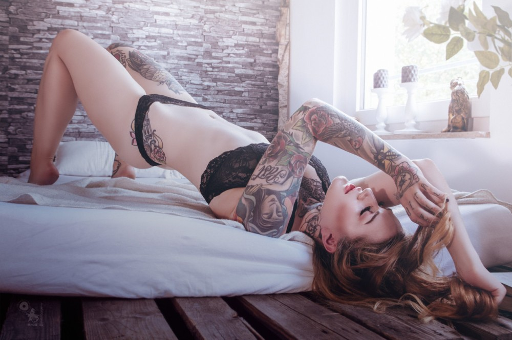 Sunny Bed - Super sexy and beautiful lingerie photo with tattoo model Laura Celina - © by Magistus