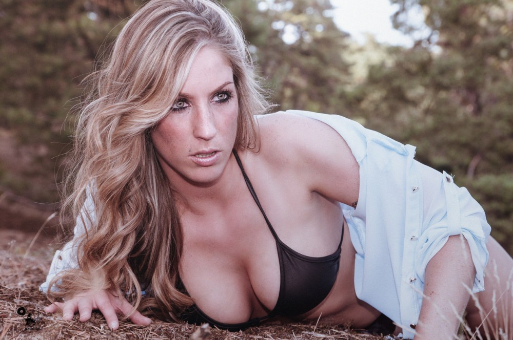 In Nature - Super Sexy Bikini picture with busty blonde model showing a big cleavage - © by Magistus