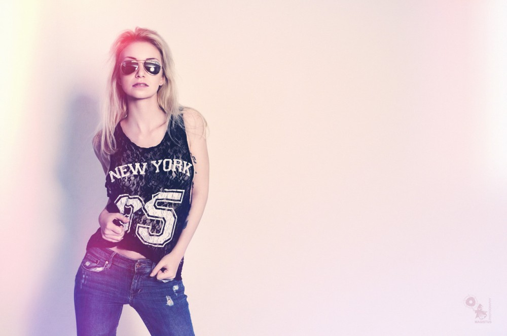 New York - Super sexy jeans portrait with hot girl wearing sunglasses and a half transparent seethrough top. - © by Magistus
