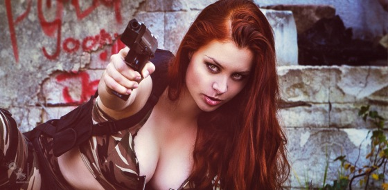 Army Babes Weapons - Super hot redhead army girl is posing with a gun showing a fantastic sexy and big cleavage. - © by Magistus