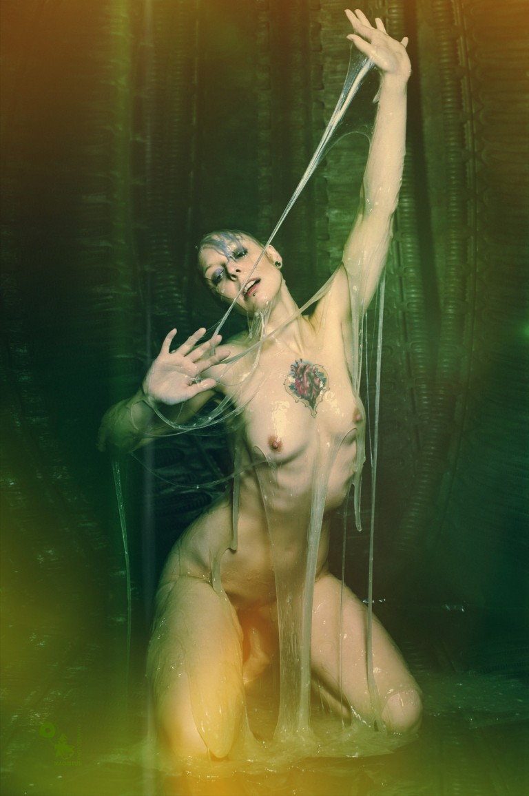 Alien Essence - Super hot and messy nude photo of a naked model posing in slime showing her tight body covered in alien essence - © by Magistus
