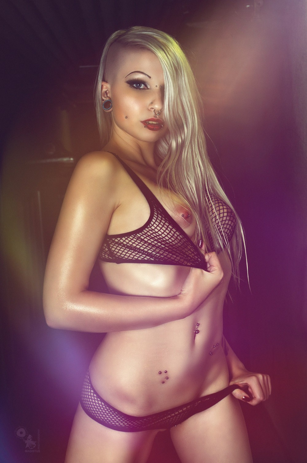 Lilith in the Dark - Super hot and sexy blonde model is posing in the dark presenting her naked pierced tits and tight body. - © by Magistus