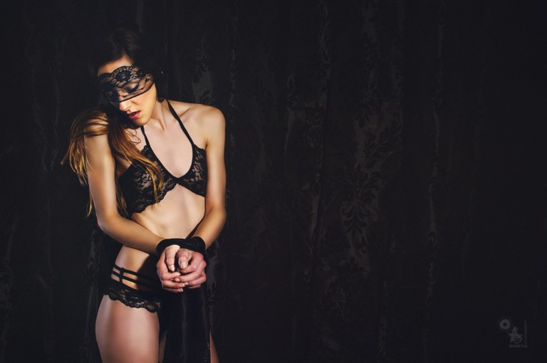 Bound Lingerie - Mega erotic fetish photo of a hot model with bound hand wearing black lingerie and a black mask - © by Magistus