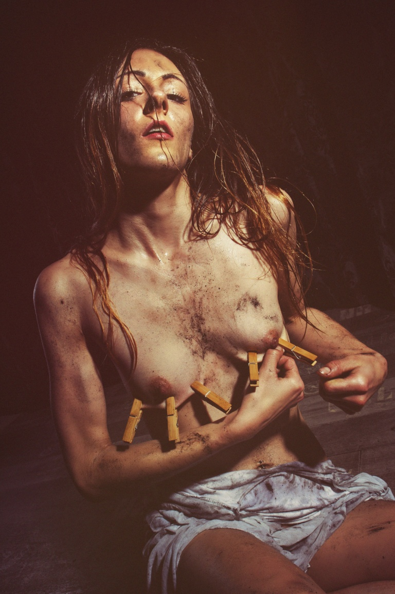 Masochistic Beauty - Mega Hot and Erotic SM Fetish Portrait with a half naked girl covered in dirt putting clamps to her naked tits. - © by Magistus