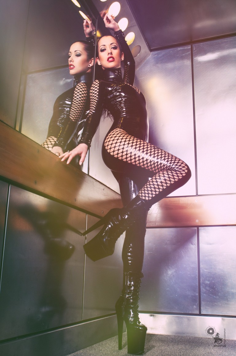 Latex Elevator - Fantastic Model is posing in an elevator wearing a super tigh, sexy and cool latex catsuite - © by Magistus