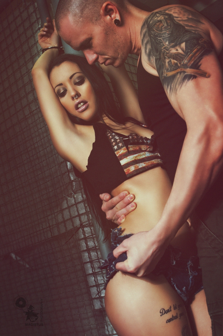 Beauty N Beast - Super hot and sexy BDSM Erotic Photo with a fantastic female model handcuffed in sexy jeans hotpants grabbed by a male model. - © by Magistus