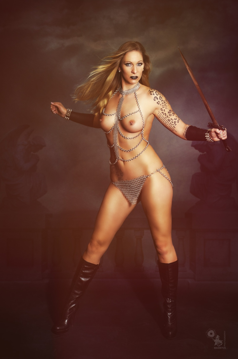 Warrior Princess - Super hot and sexy naked fightergirl is posing in chainmail lingerie with a sword shwoing off her super hot body and naked pierced boobs - © by Magistus