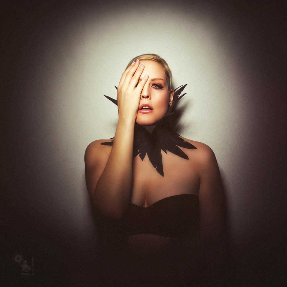 Black Feathers - Lingerie Portrait in the spot light - © by Magistus