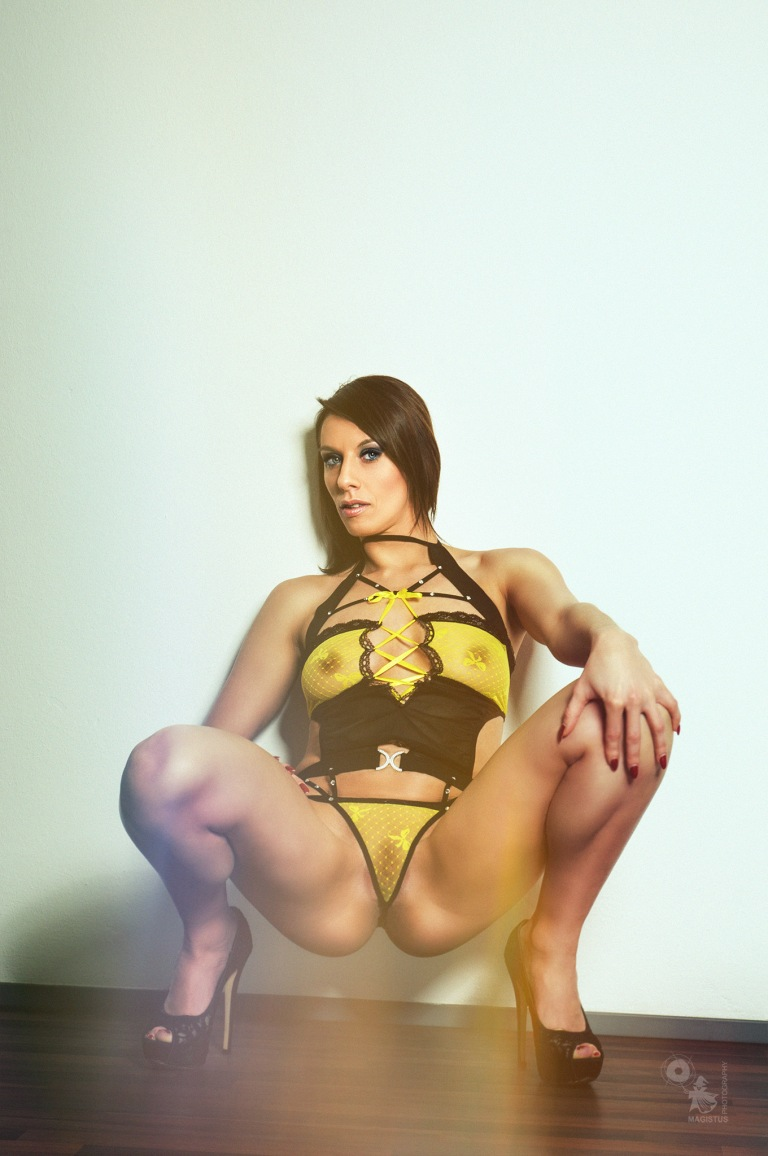 Yellow Erotic - Super hot and sexy girl is posing wide spread in yellow transparent lingerie showing her half naked boobs and pussy - © by Magistus
