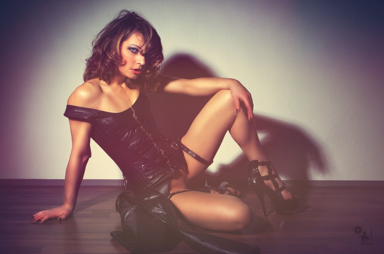 Black Leather - Super sexy erotic model is posing bottomless in a black corsage spreading her legs showing her naked crotch - © by Magistus