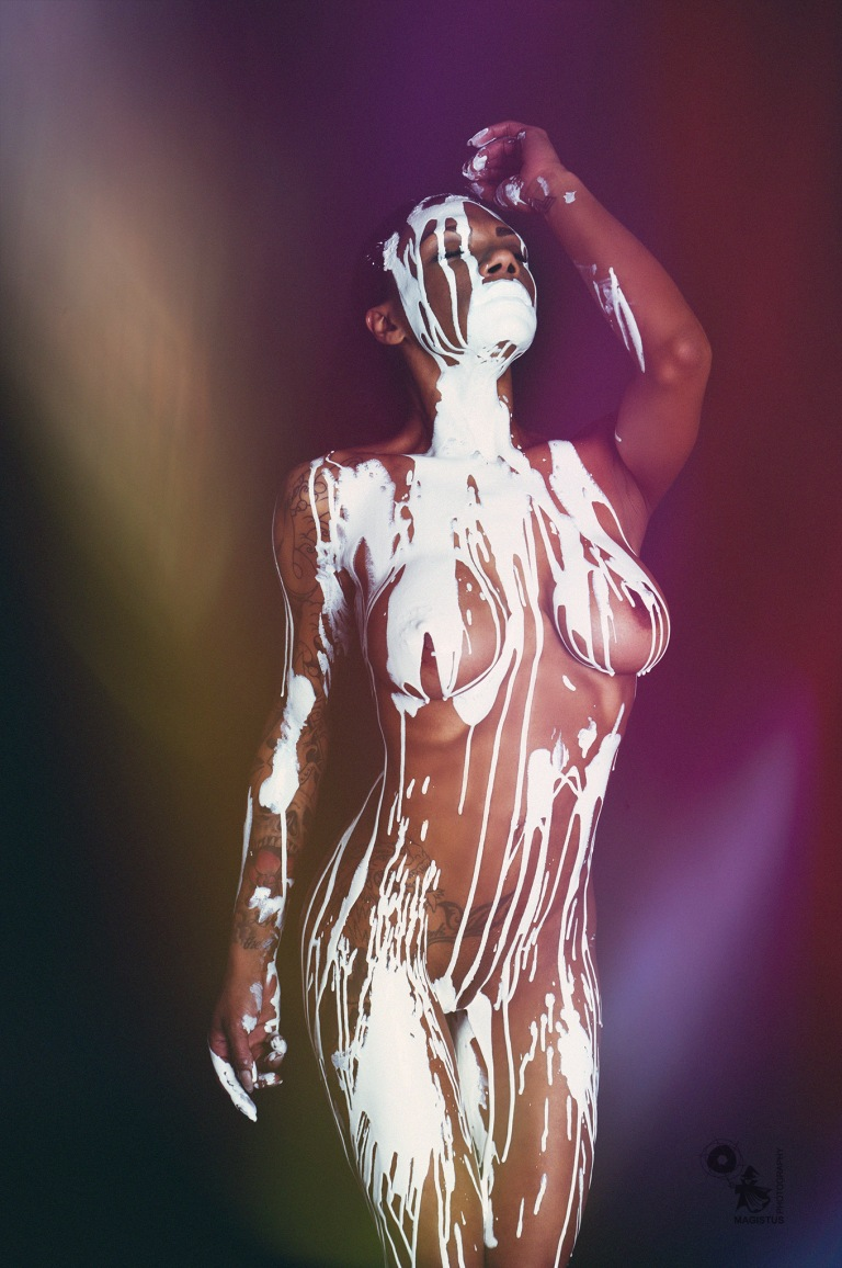 White - Super fantastic and hot black bombshell with white bodypainting color running down her fantastic naked body - © by Magistus