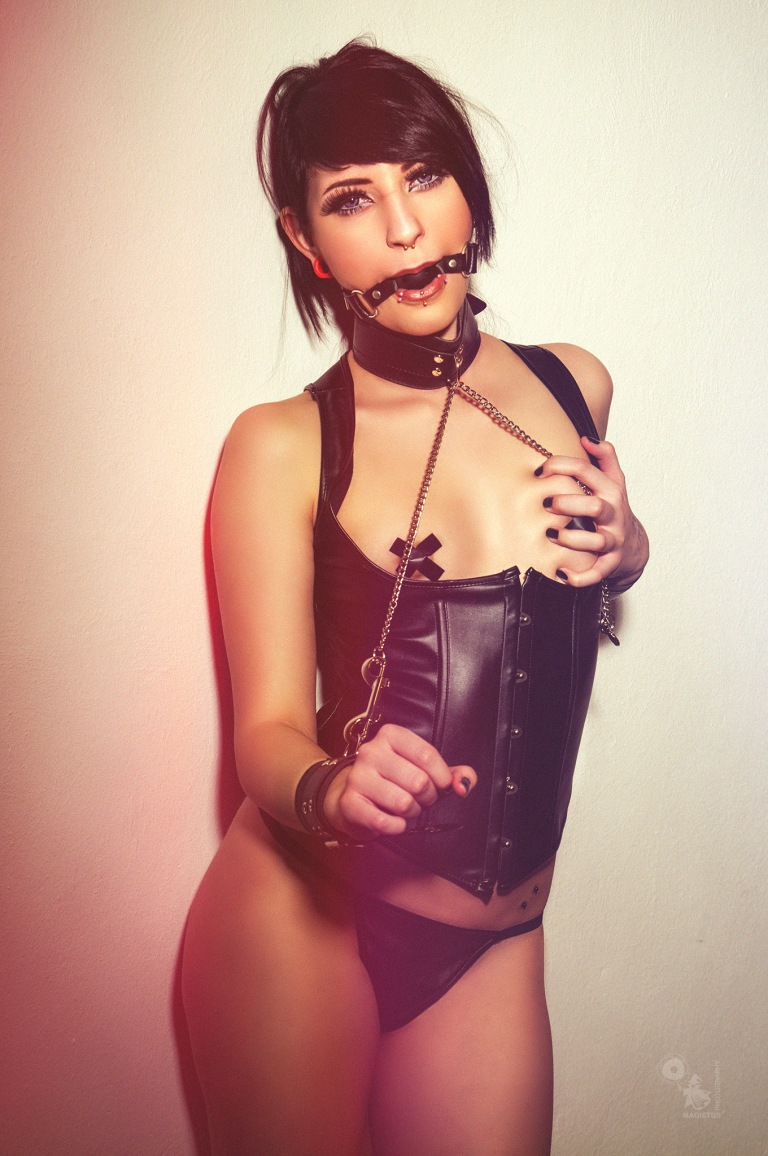 Fetish Girl - Super hot and sexy girl is posing gagged and bound with her naked tits nipple taped wearing a black corsage - © by Magistus