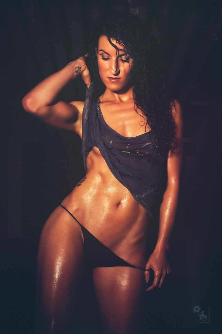 Wet, Dark & Sexy - super hot fitness model is posing sexy in a dark place showing her fantastic sixpack - © by Magistus