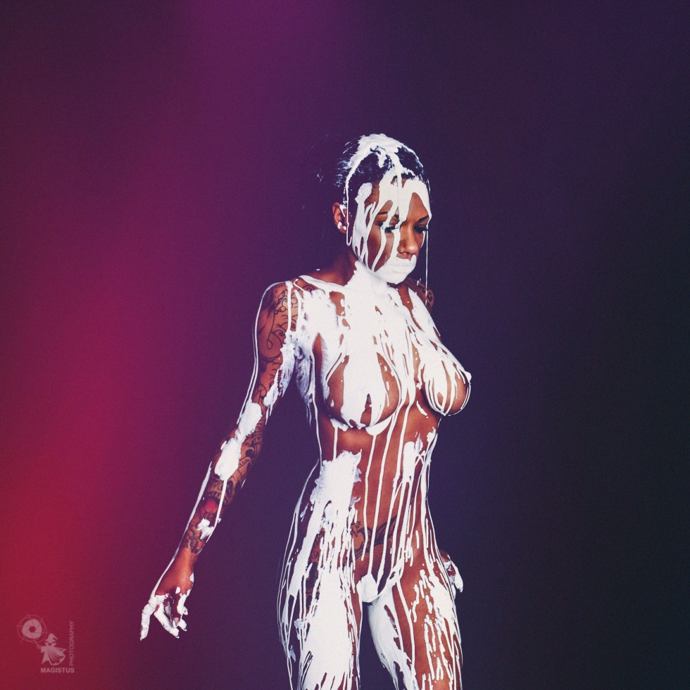 White Nude - Nude Art Bodypainting with a busty black model posing fully naked covered in white color dripping down her perfect body. - © by Magistus