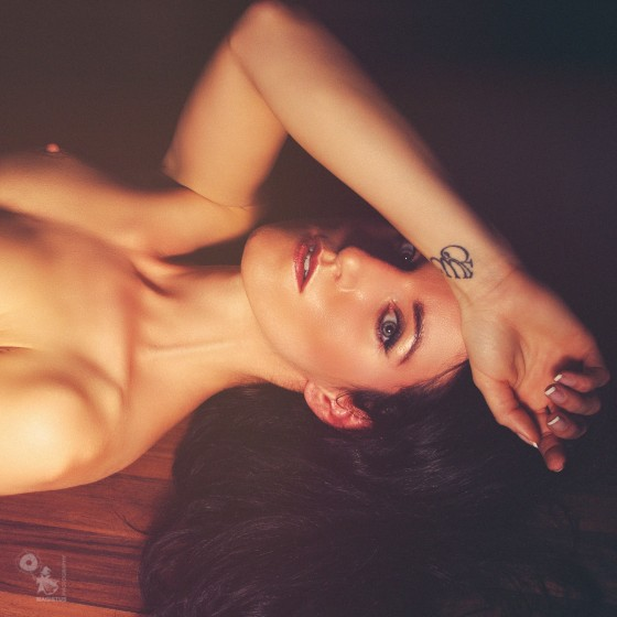 Dark Intimicy - Super beautiful and erotic nude art photo of a fantastic fitness model posing naked on the floor with her hand on her pussy - © by Magistus