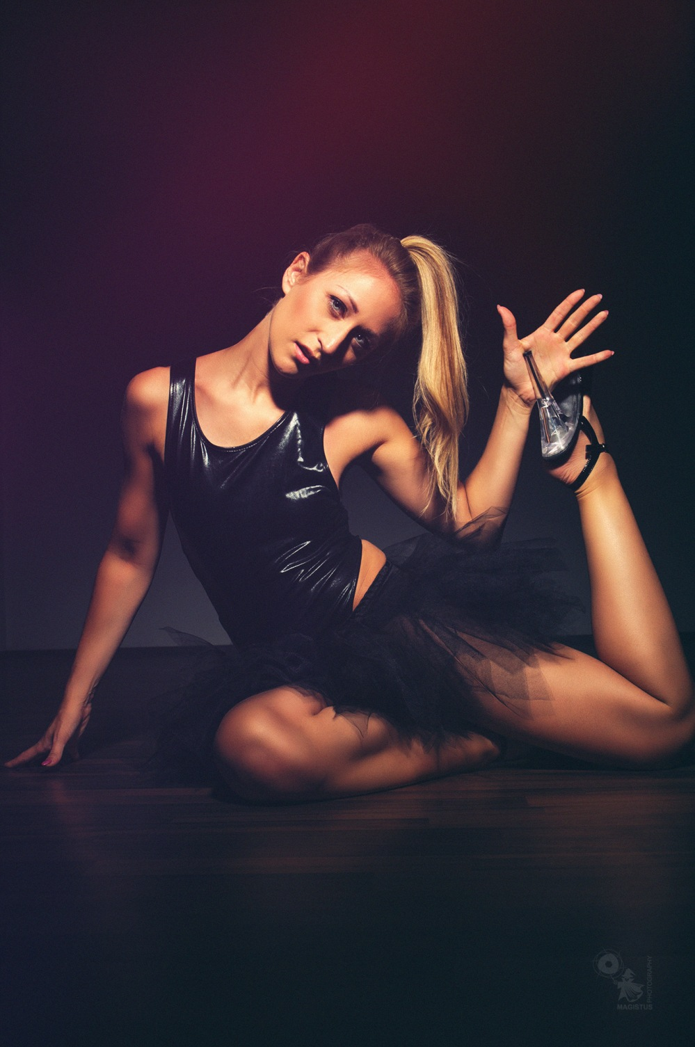 Black Swan - Super beautiful and sexy girl is posing in ballerina style in a black body - © by Magistus