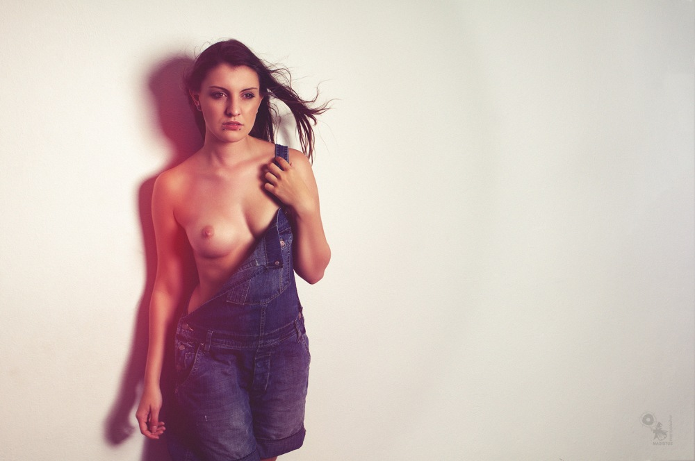 Sexy Denim Bib - super hot and sexy girl is posing topless in a denim bib showing her beautiful naked boobs - © by Magistus