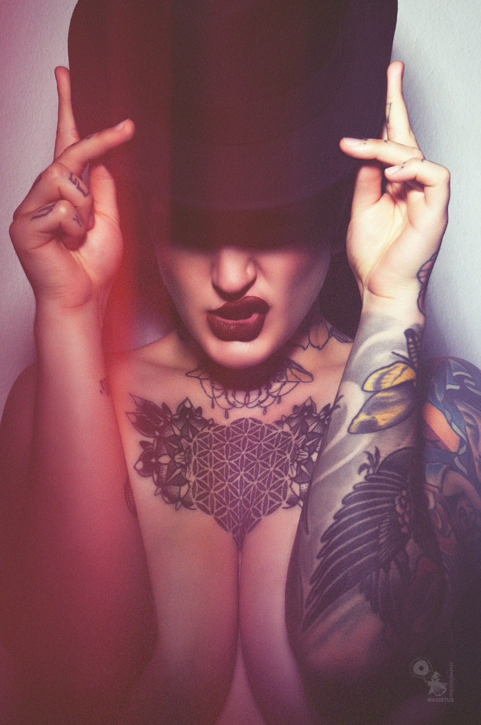Close up - super coole close up portrait with a tattooed alternative model showing a big cleavage. - © by Magistus