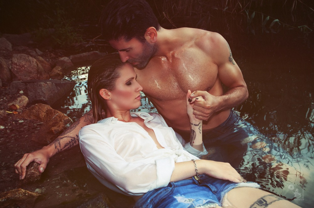Wetlook Love - Fantastic female and male model posing in the water wearing wet jeans and seethrough shirt. - © by Magistus