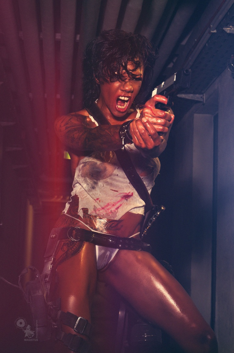 Aggressive Fighter - mega hot and sexy fighter girl in seethrough wetlook cloths showing her big boobs with a gun in her hands - © by Magistus