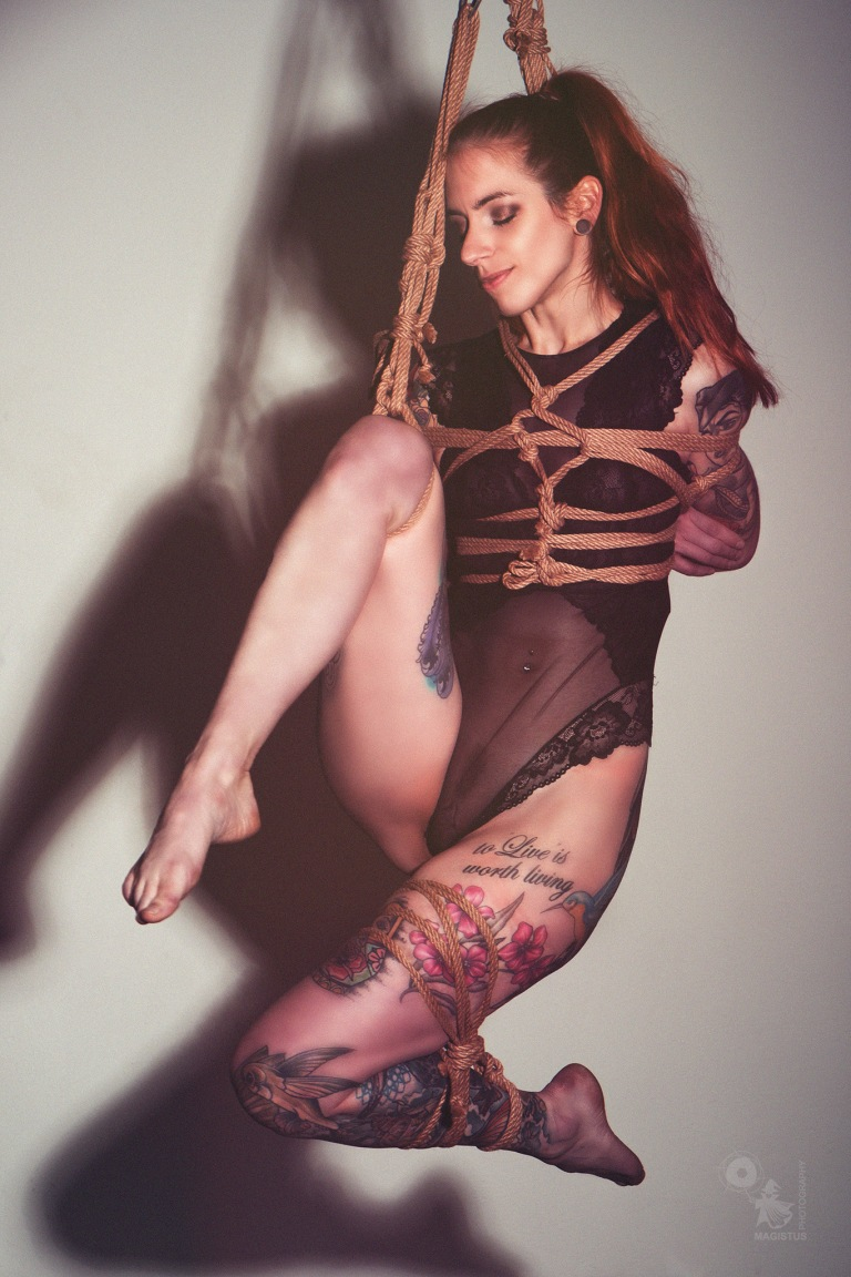 Hanging Beauty - super beautiful tattooed alternativ model is hanging with fantastic rope work wearing black transparent lingerie - © by Magistus - Rope Work by Herr Pieps