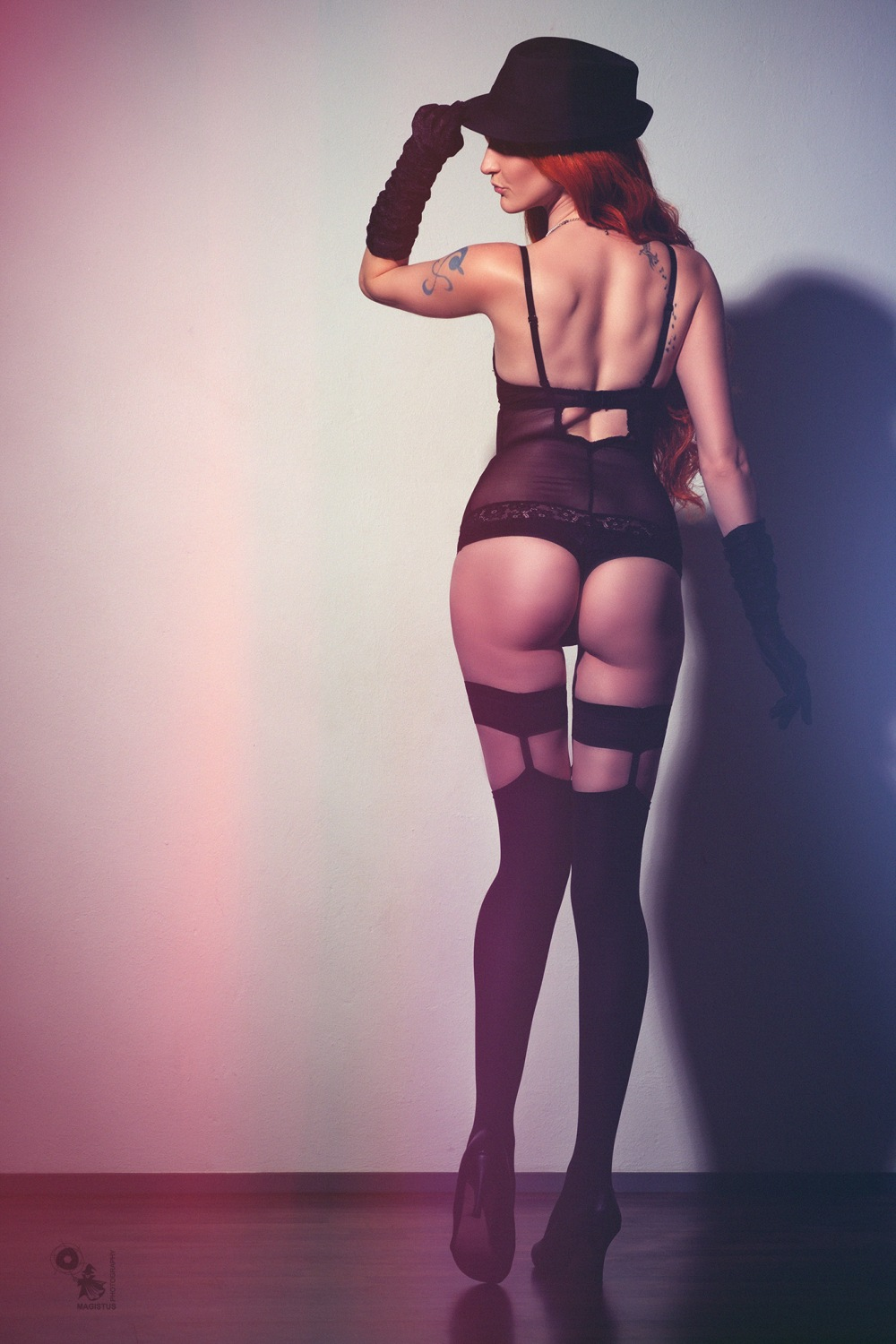 Lingerie Booty - super sexy girl posing in black lingerie showing her fantastic booty - © by Magistus