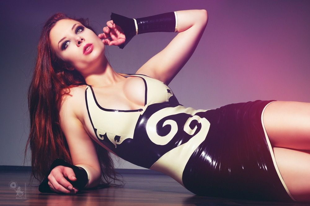 Latex Beauty - super sexy and busty model is posing in a latex dress showing a fantastic cleavage - © by Magistus