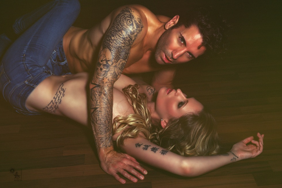 Jeans Love - super sexy boy and girl tattoo model posing topless together wearing blue jeans. - © by Magistus