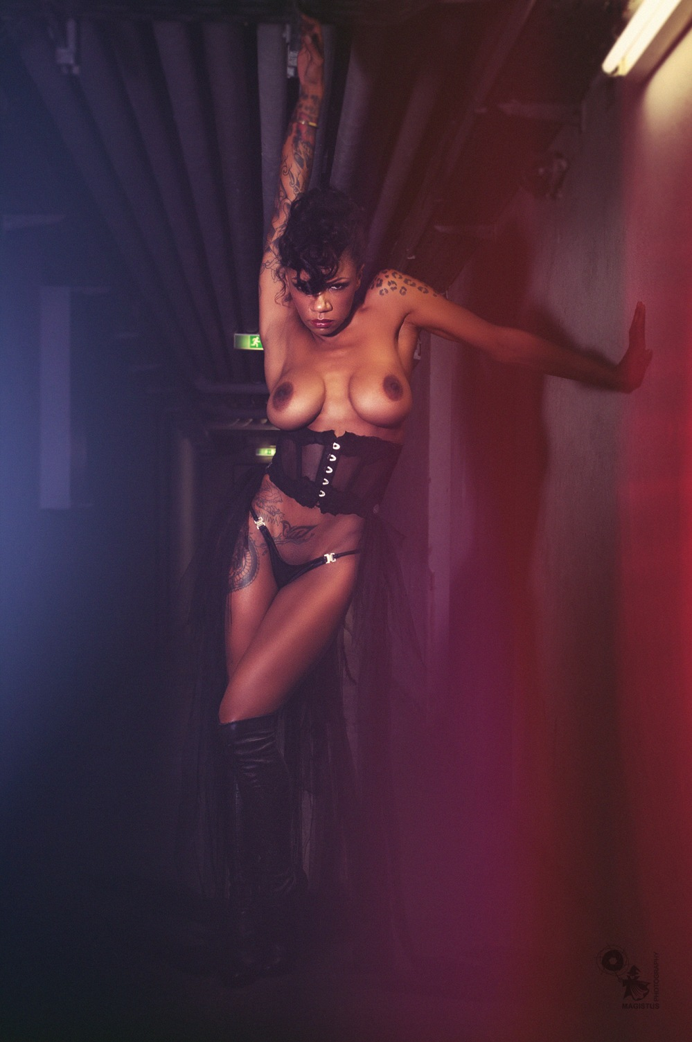 Fetish Beauty - super coole and half naked black tattoo model is posing topless in a black corsage showing her big boobs - © by Magistus