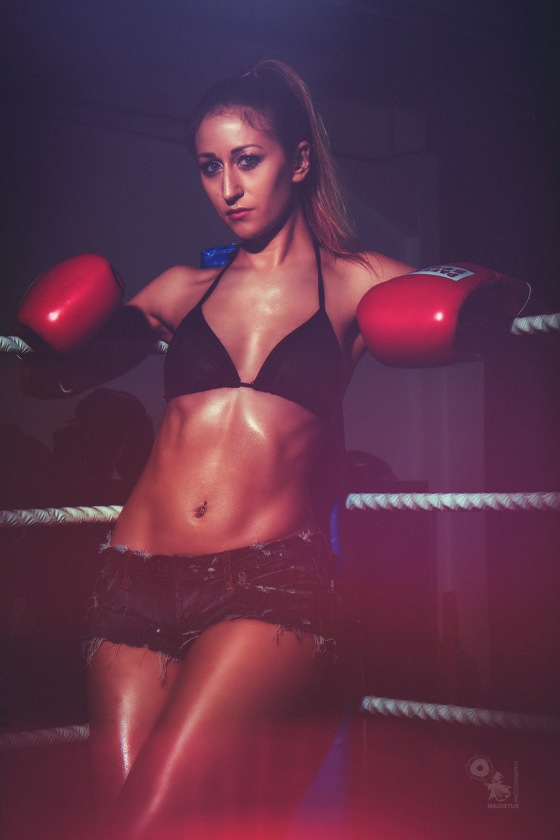 Boxing - super hot and sexy fighter girl is posing in a boxing gym wearing a bikini top and sexy jeans hotpants. © by Magistus