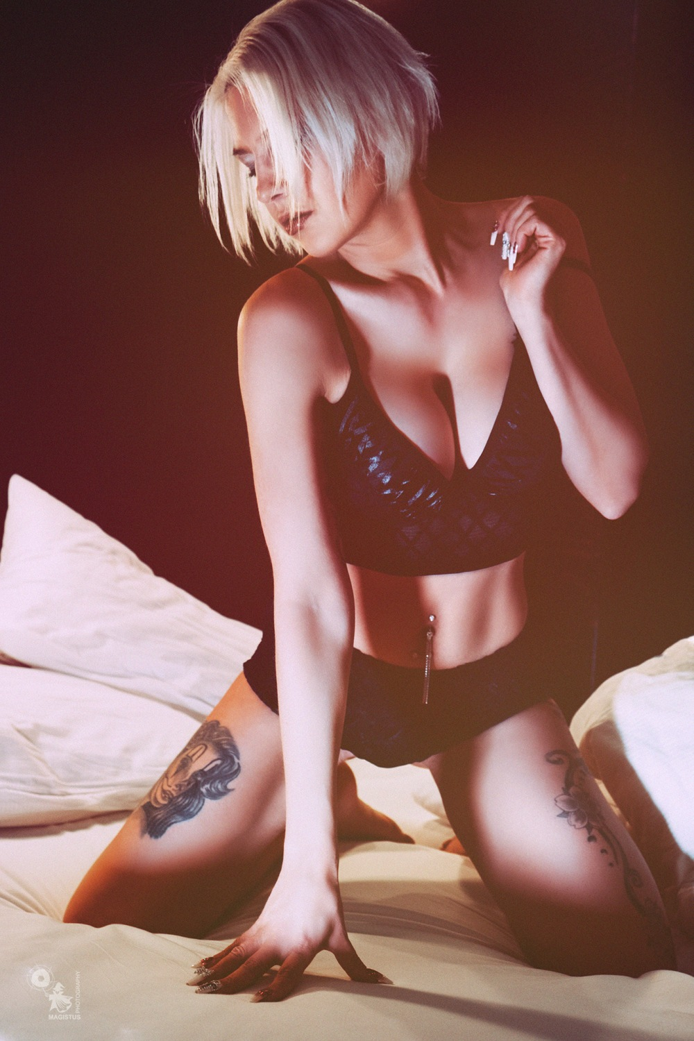 Light Lingerie - super sexy and busty girl is posing on the bed wearing black lingerie showing a big cleavage - © by Magistus