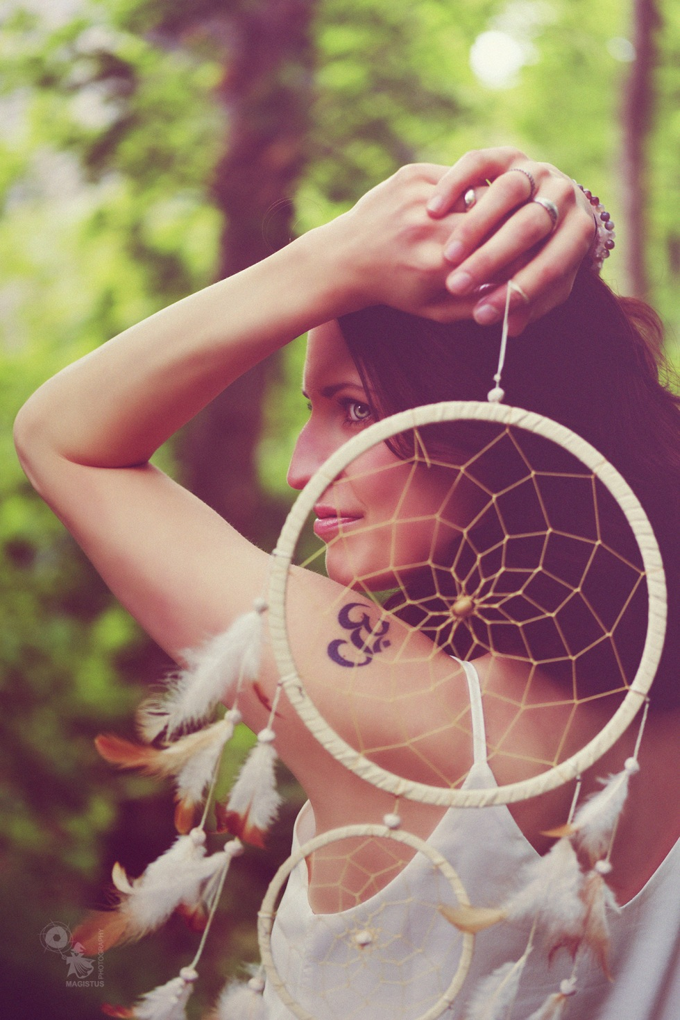 Dreamcatcher - beautiful portrait of fantastic girl posing with a dreamcatcher in the nature. - © by Magistus
