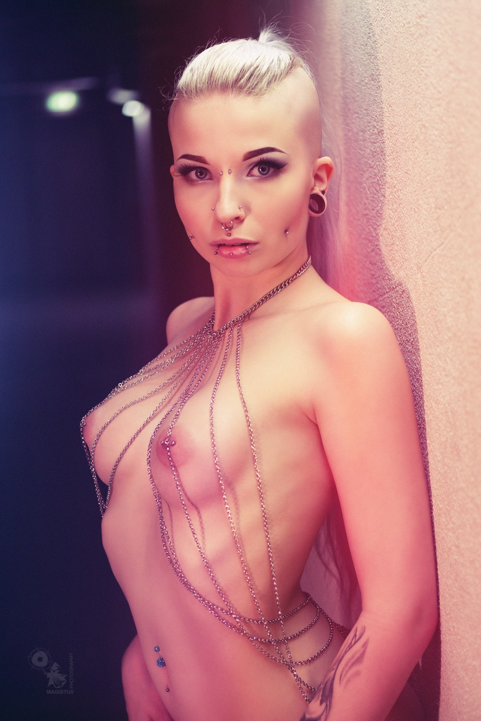 Lilith - super sexy and beautiful nude alternative model is posing naked in a dark place showing her pierced boobs