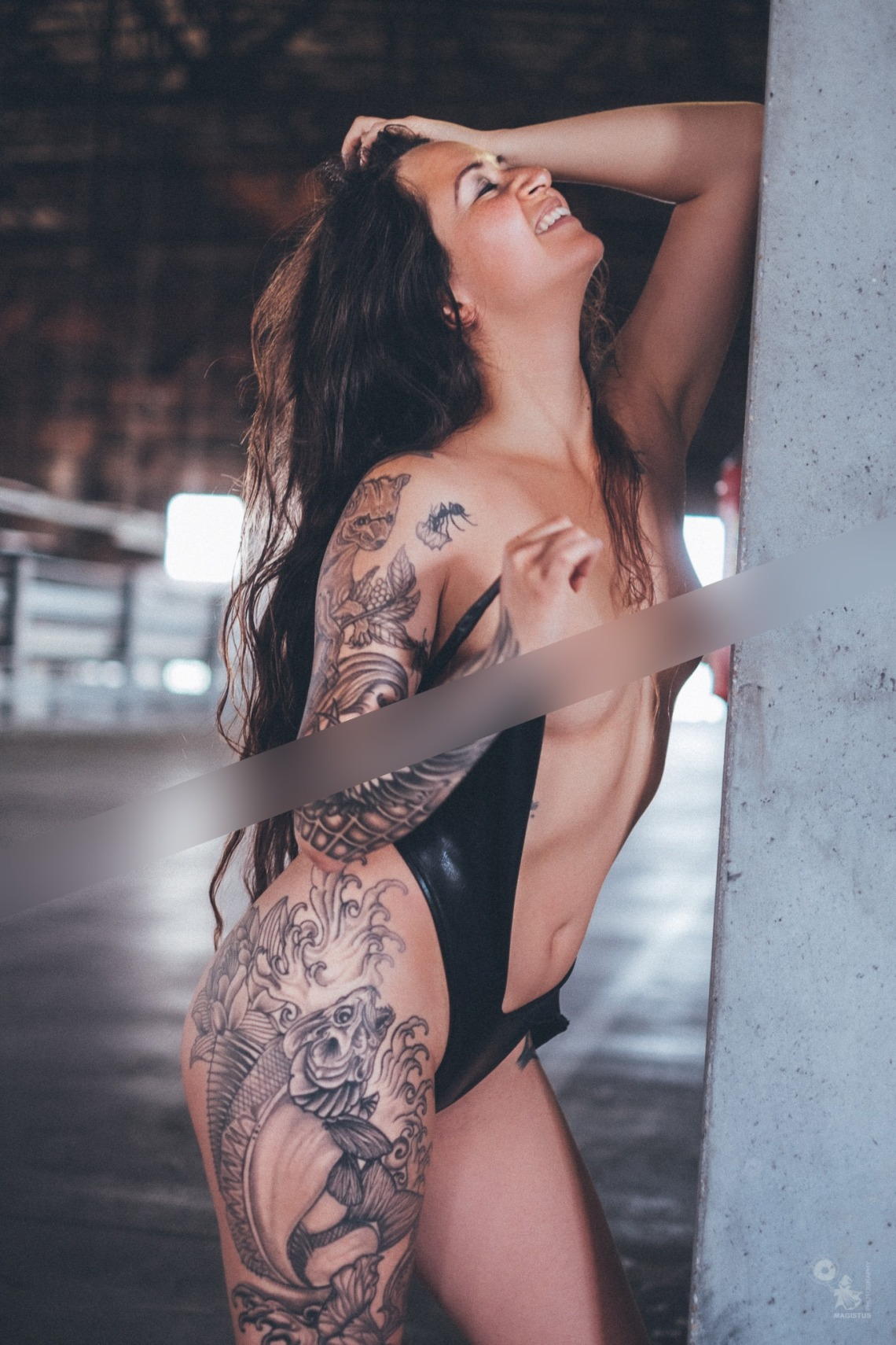 Censored sexy tattoo model is posing topless