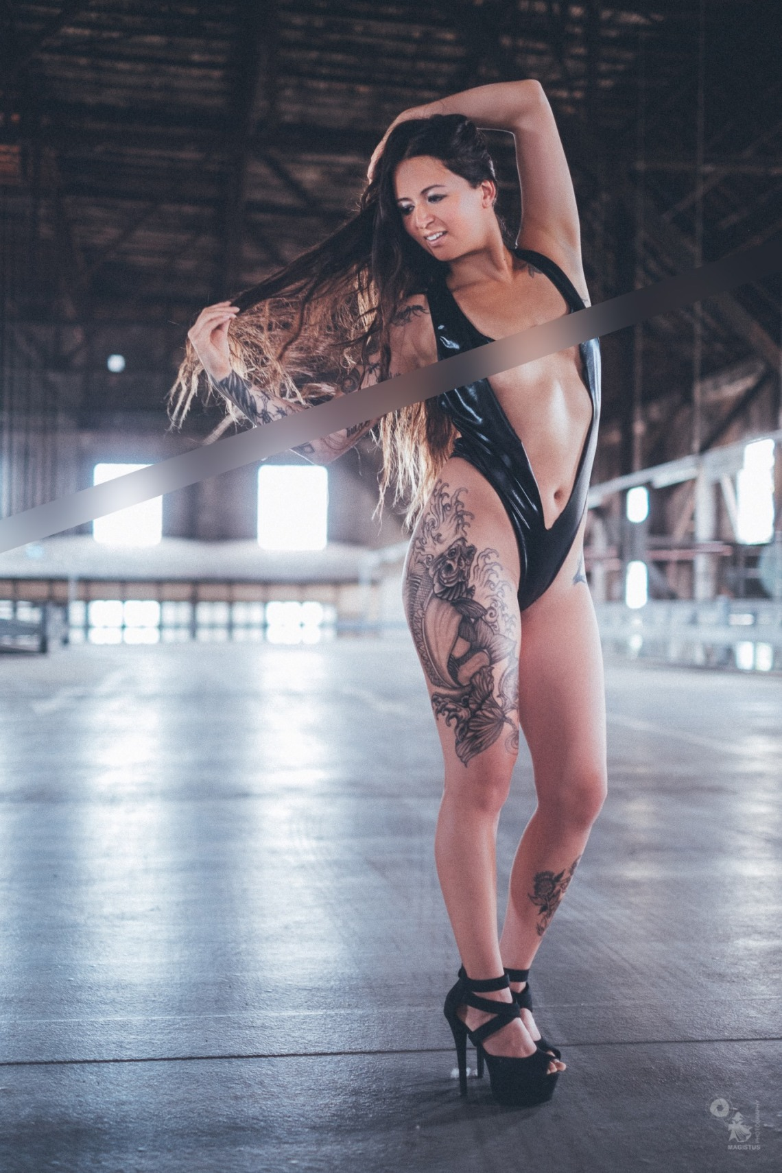 Super sexy tattoo model is posing topless