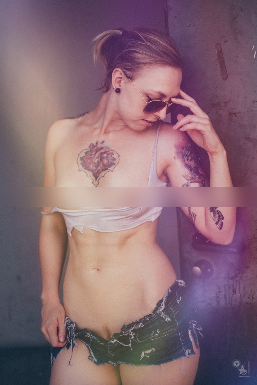 Sexy topless tattoo girl in hotpants