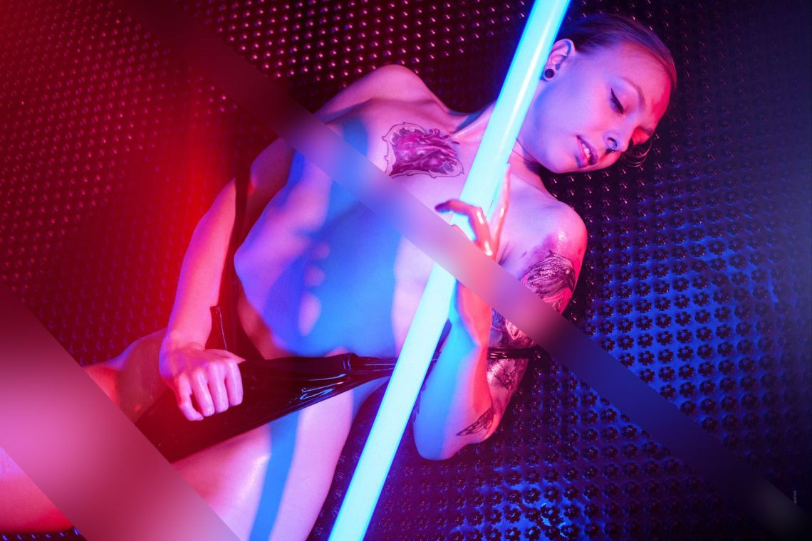 Sexy half naked and topless model in colorful light